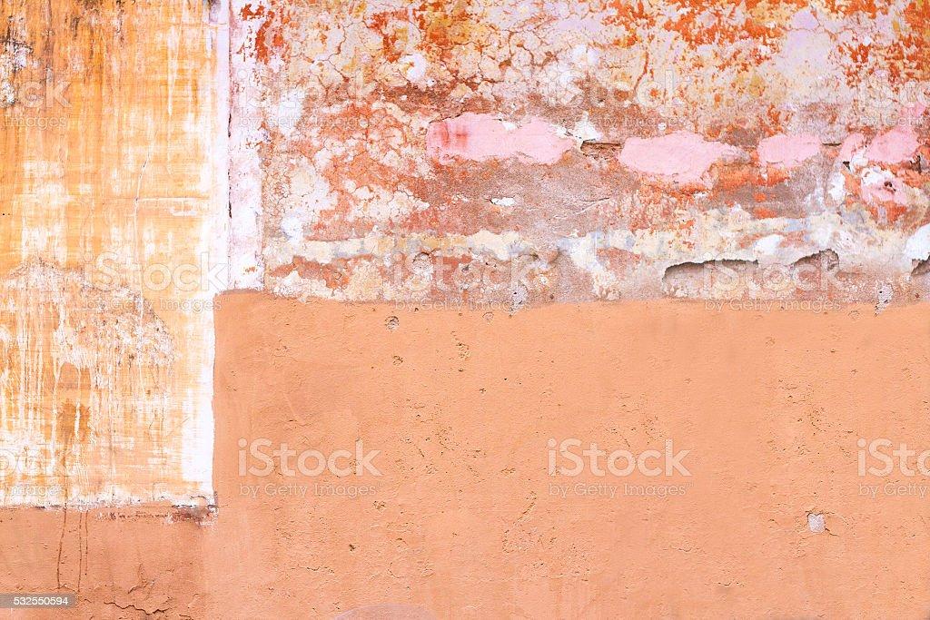 Orange-Pink-Yellow Mottled Roman Wall Background Texture stock photo