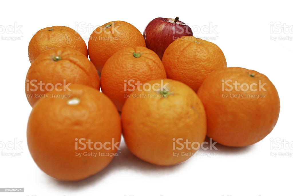 oranges and apple on white background royalty-free stock photo