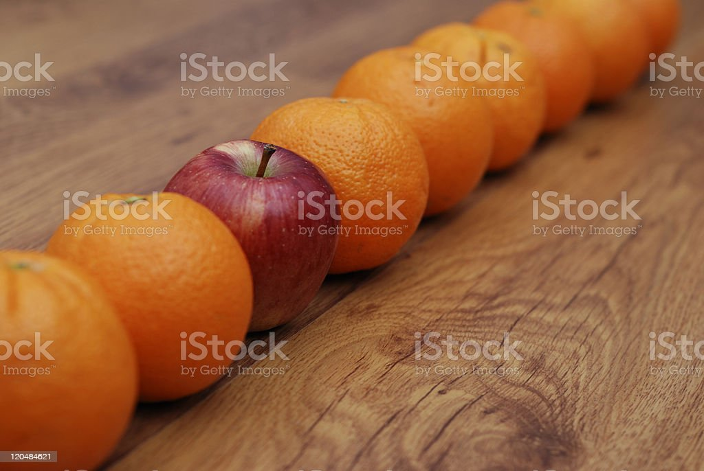 oranges and apple on wood royalty-free stock photo