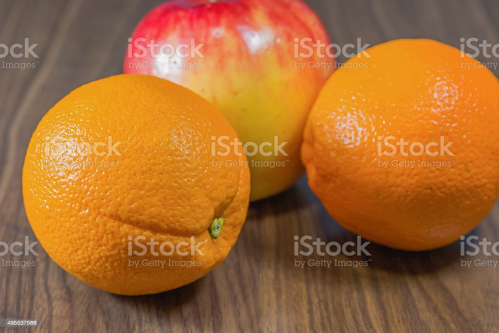 Oranges and apple. stock photo