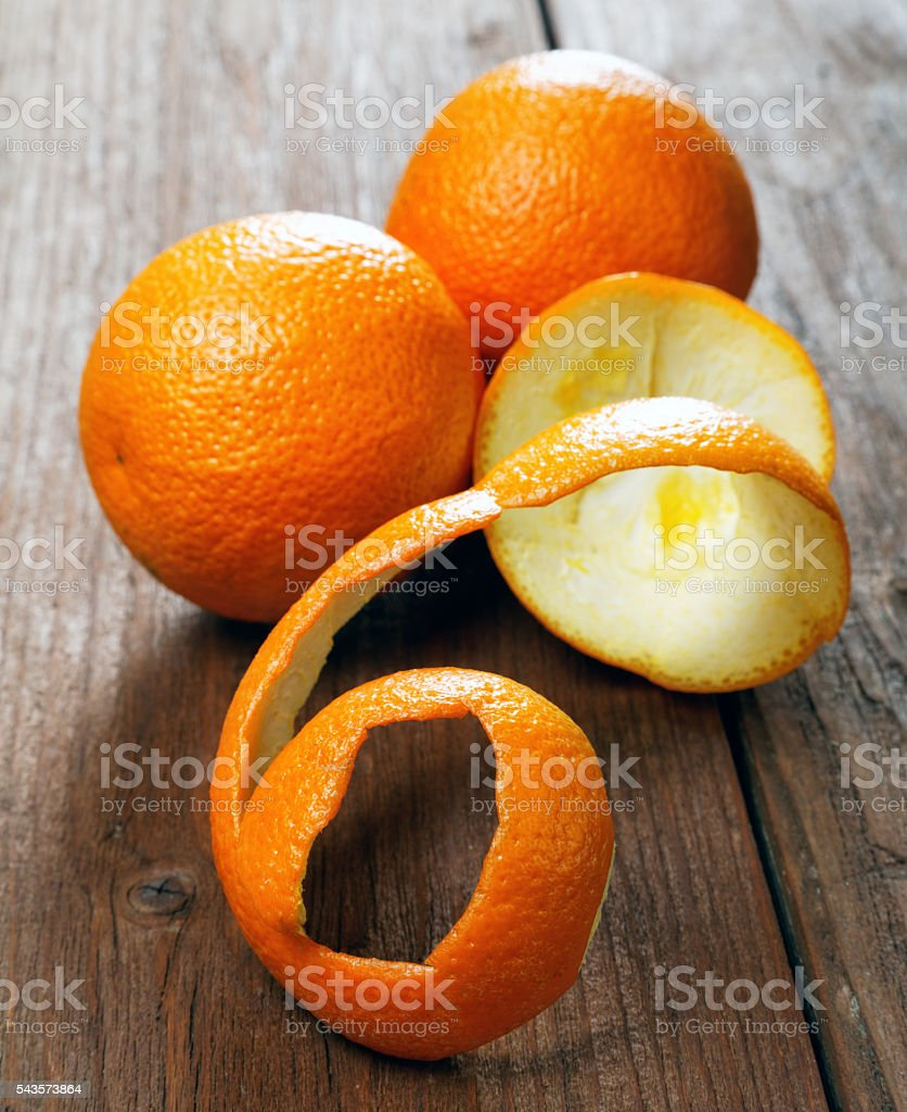 Oranges and dried peel on a rural table stock photo