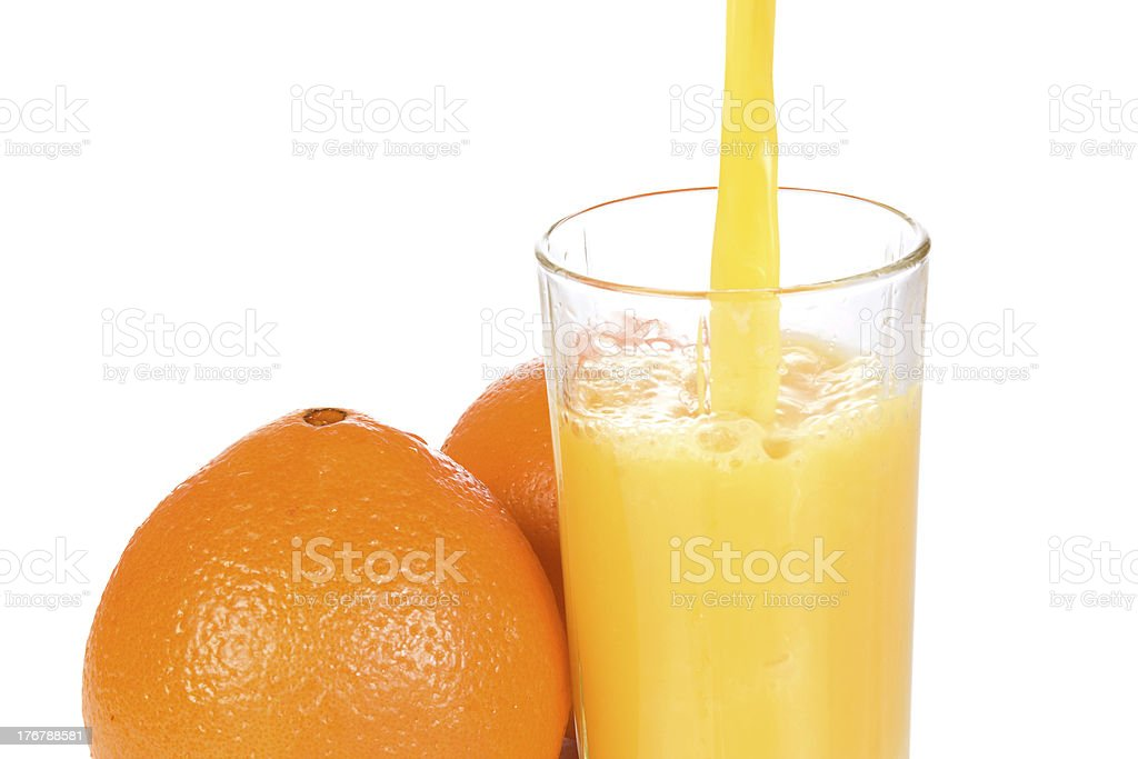 oranges and half juice in glass royalty-free stock photo