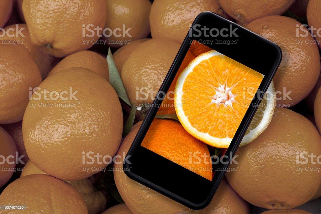 Oranges and iphone stock photo