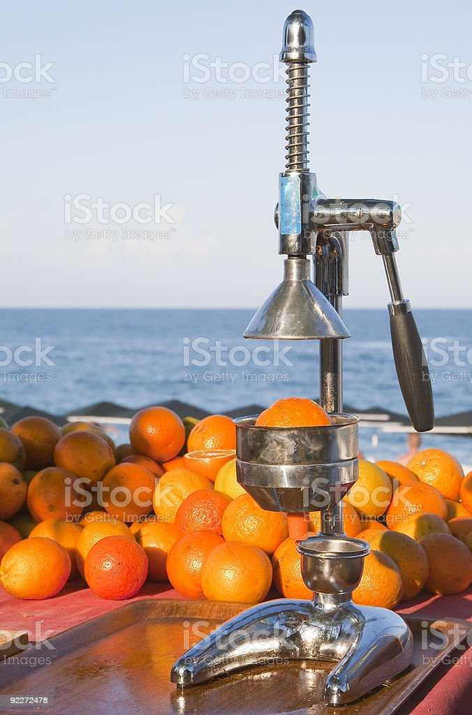 Oranges and manual press royalty-free stock photo