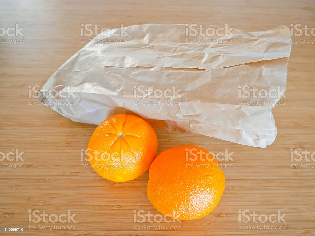 Oranges and paper bag stock photo