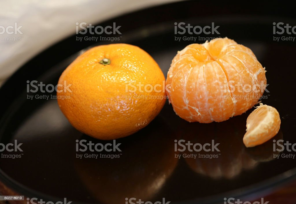 Oranges and Reflections on a Black Tray stock photo