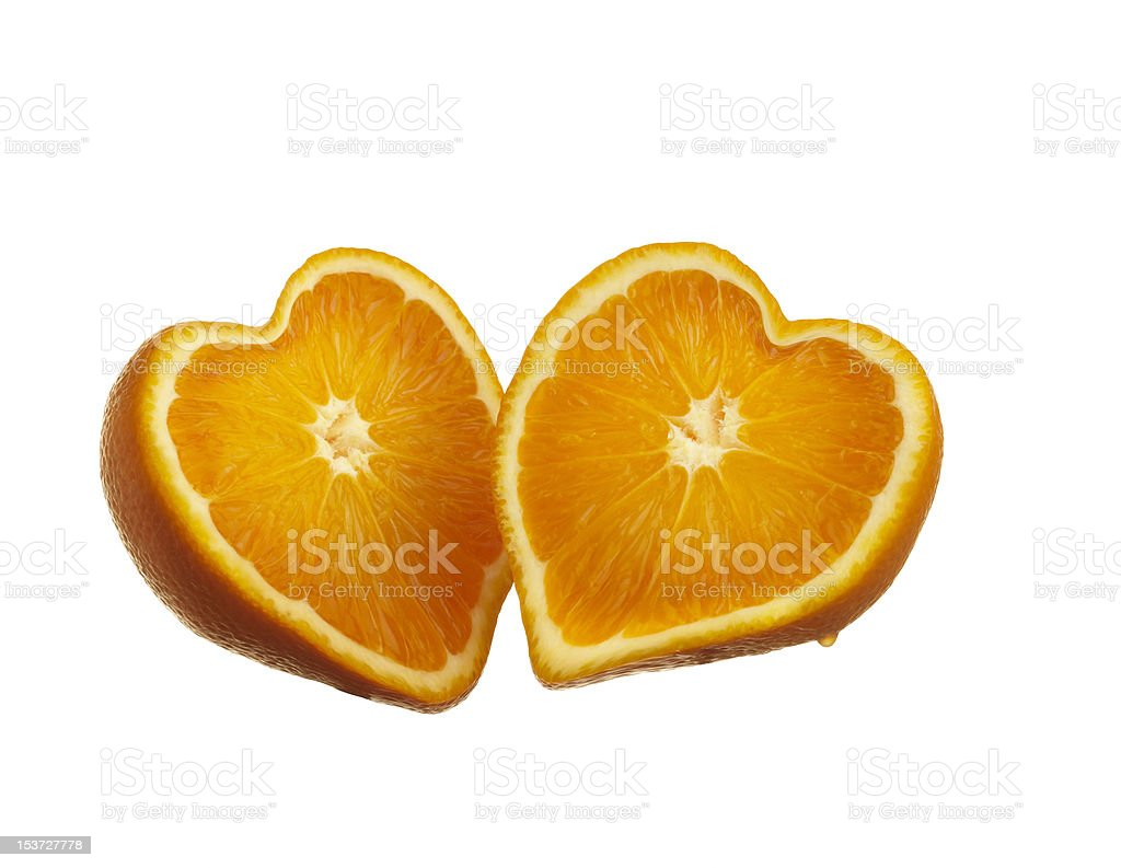 Oranges cut up in heart shaped isolated on white background stock photo