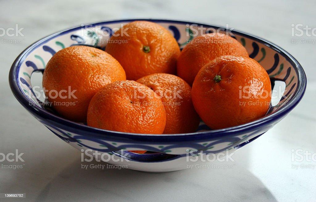 Oranges in  ceramic dish stock photo