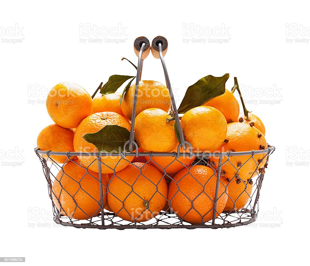 Oranges in metal wicker basket stock photo