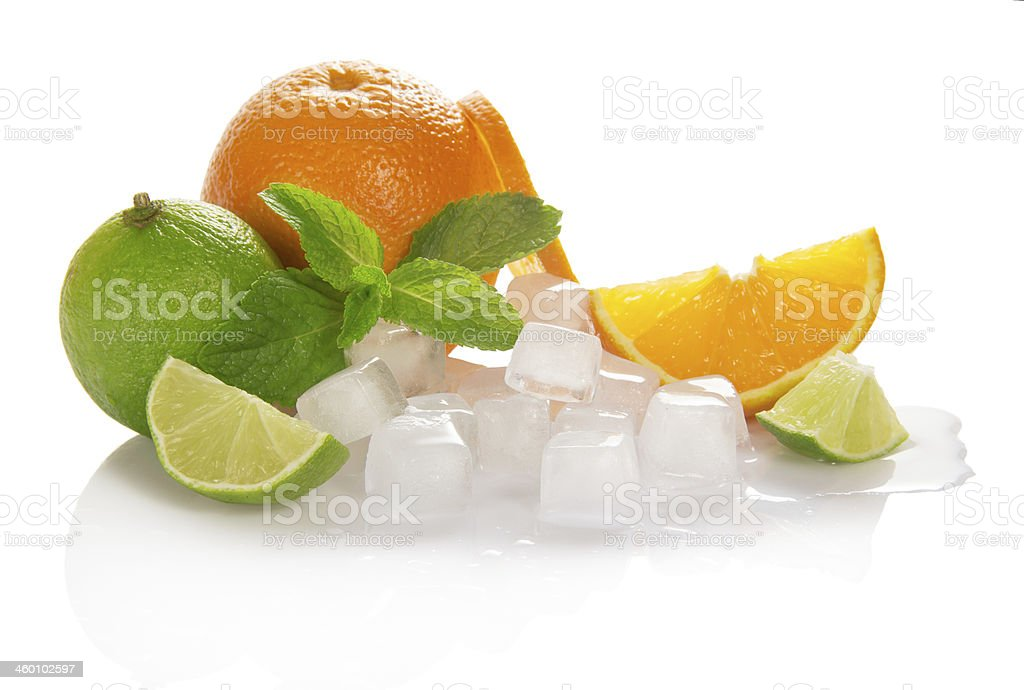 Oranges, limes and mint with cubes of ice stock photo