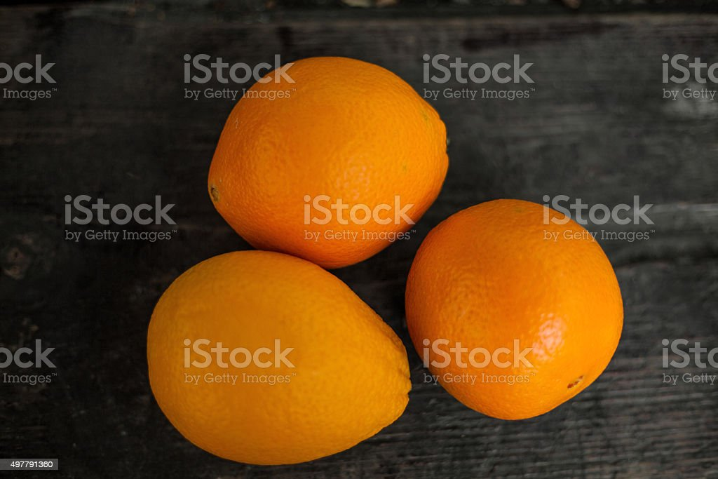 Oranges on a wooden table royalty-free stock photo