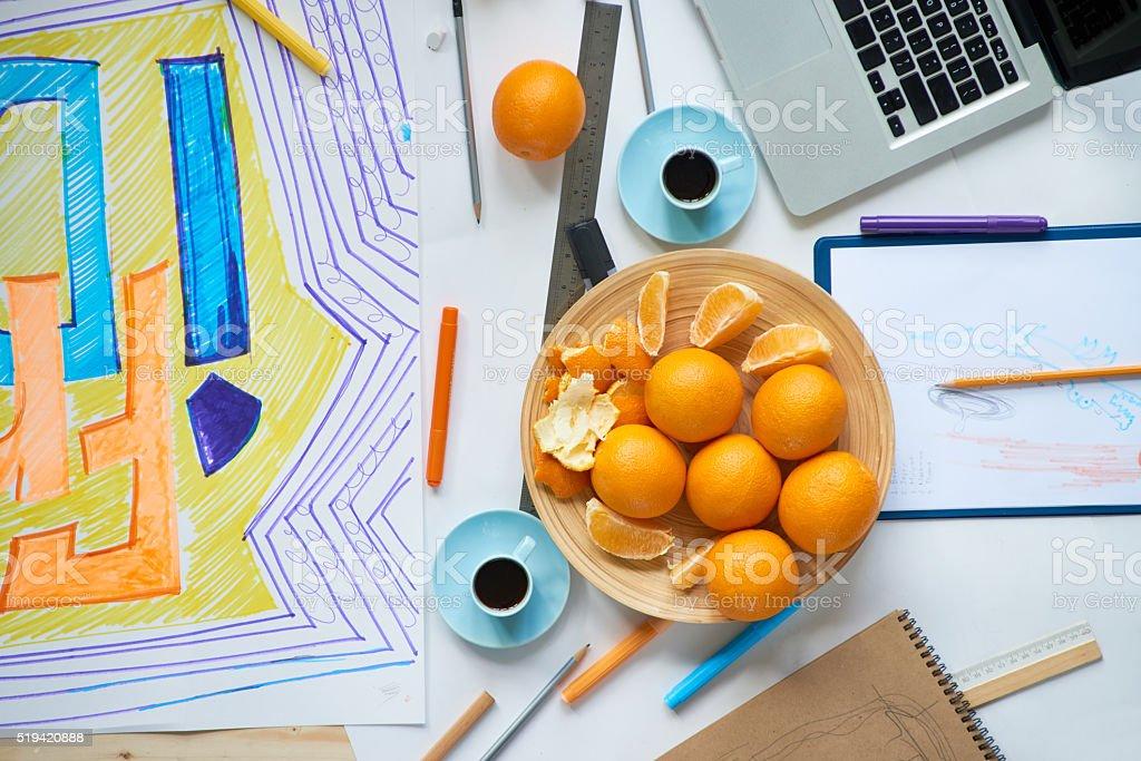 Oranges on desk stock photo