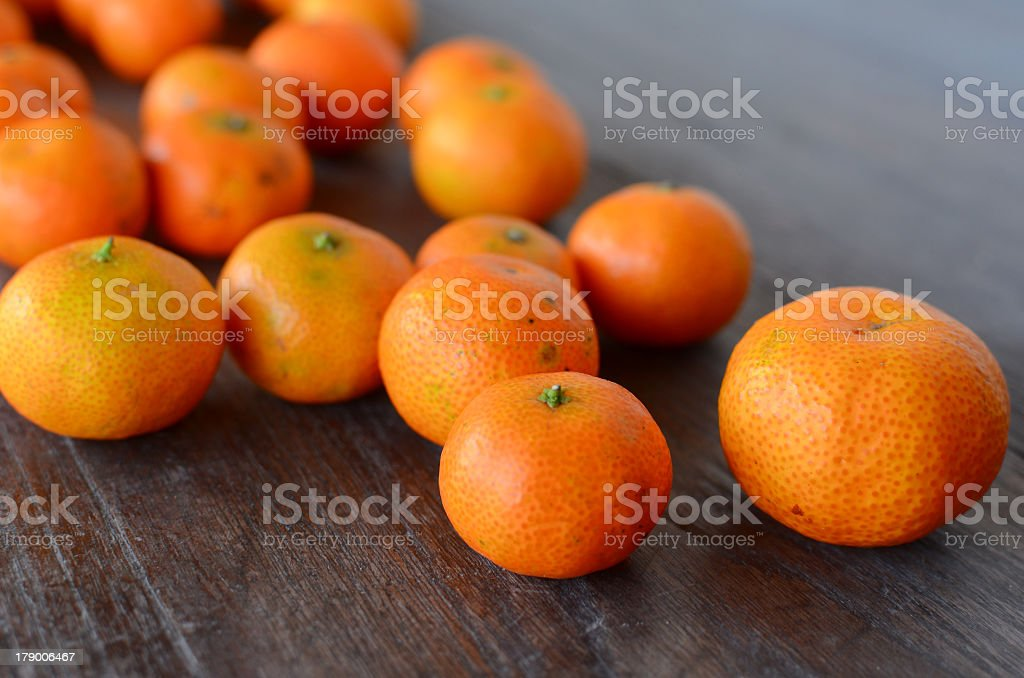 Oranges on Wood Table royalty-free stock photo