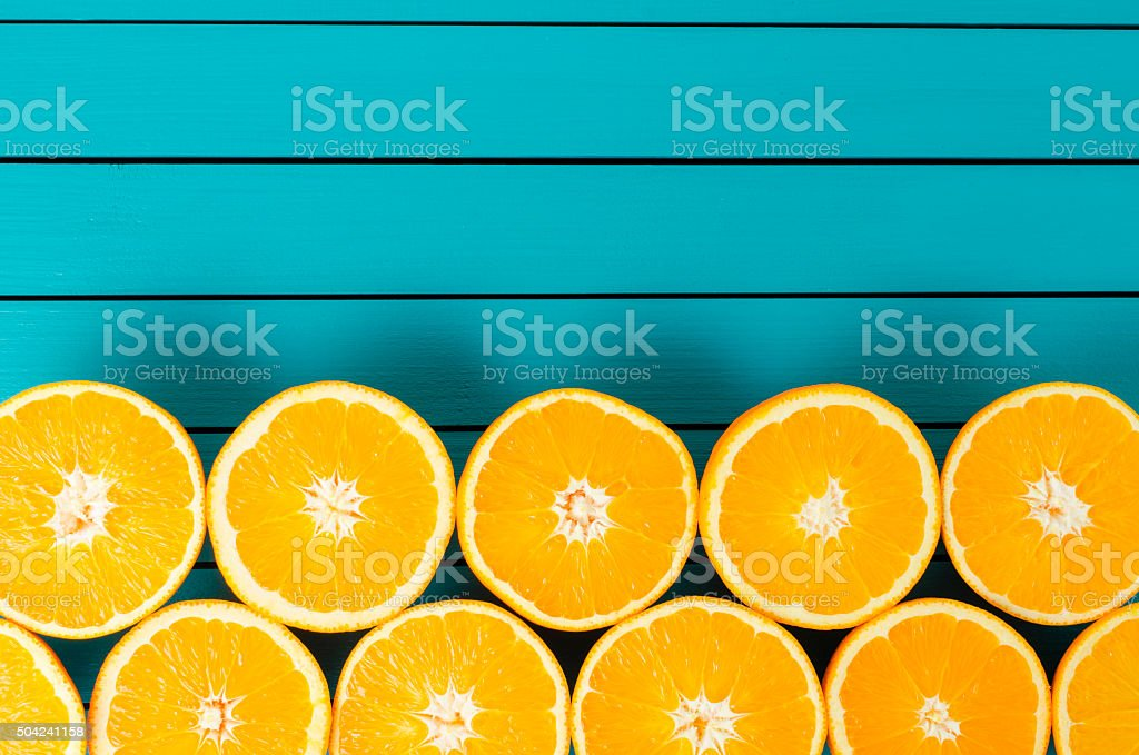 Oranges on wooden table stock photo