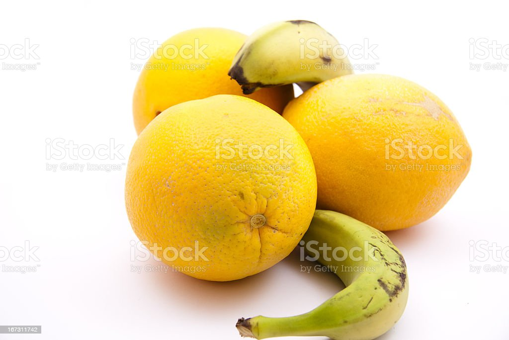 Oranges with bananas royalty-free stock photo