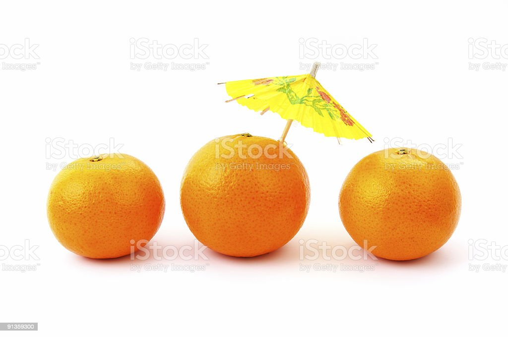Oranges With Cocktail Umbrella royalty-free stock photo