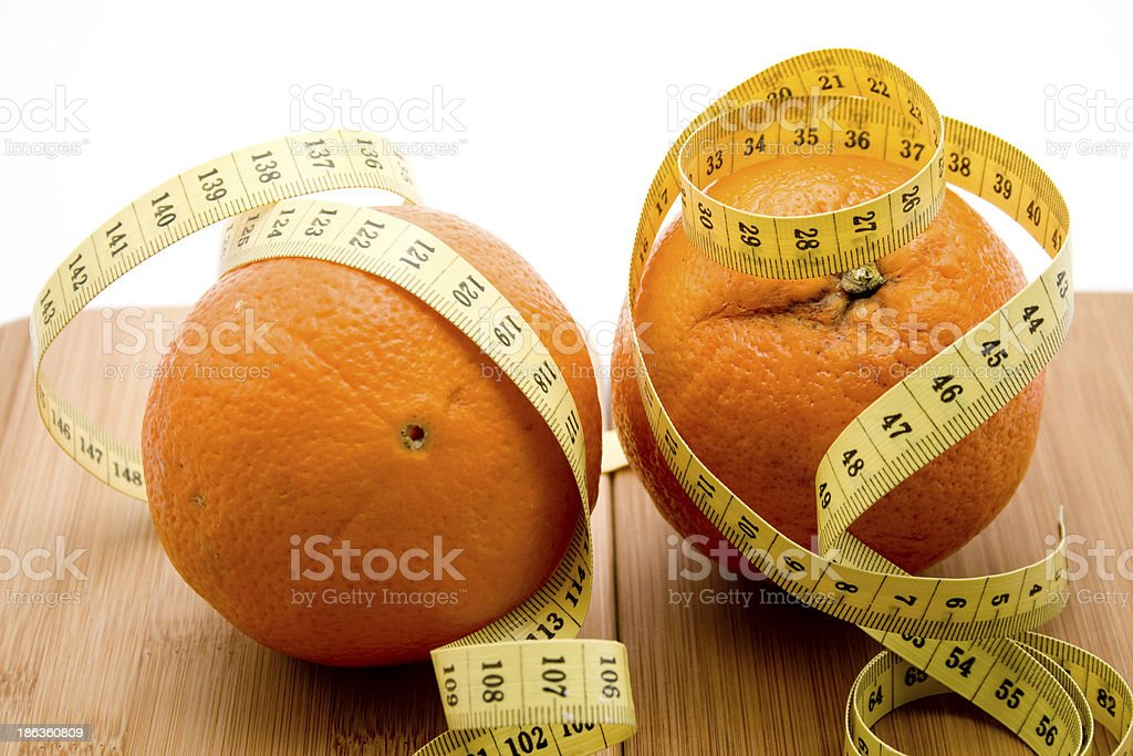Oranges with measuring tape royalty-free stock photo