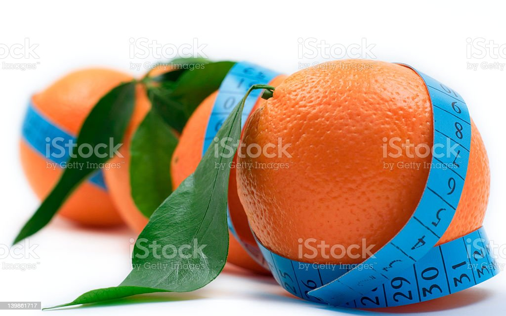 Oranges wrapped around a tape royalty-free stock photo