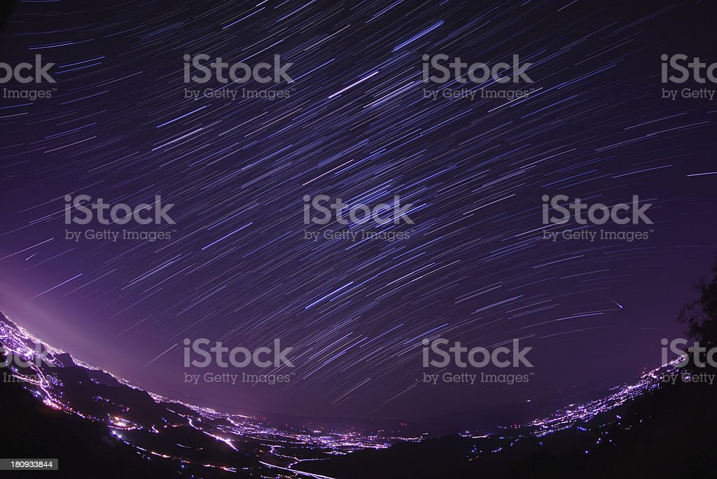 Orbiting and shooting stars royalty-free stock photo