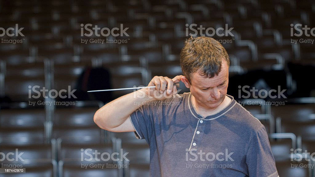 Orchestra conductor consulting his score stock photo