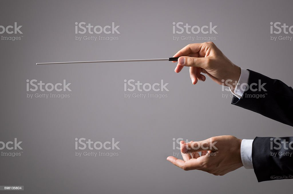 Orchestra conductor hands stock photo
