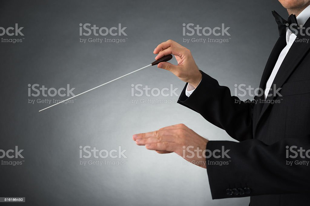 Orchestra Conductor Holding Baton stock photo