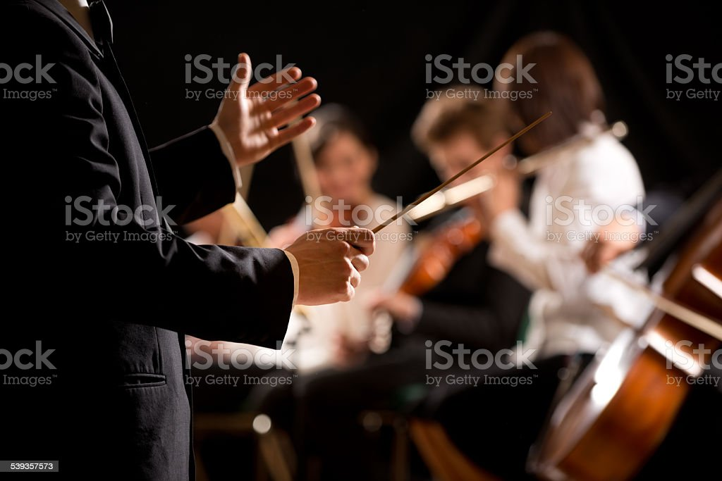 Orchestra conductor on stage stock photo