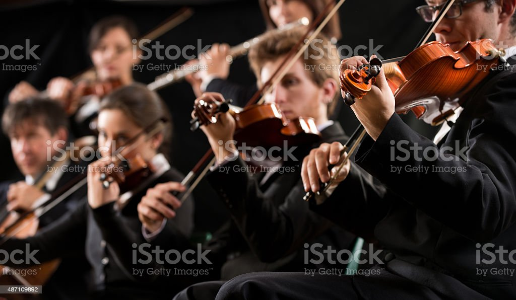 Orchestra first violin section stock photo