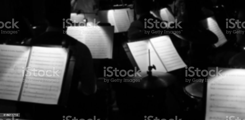 Orchestra pit showing music in black and white stock photo