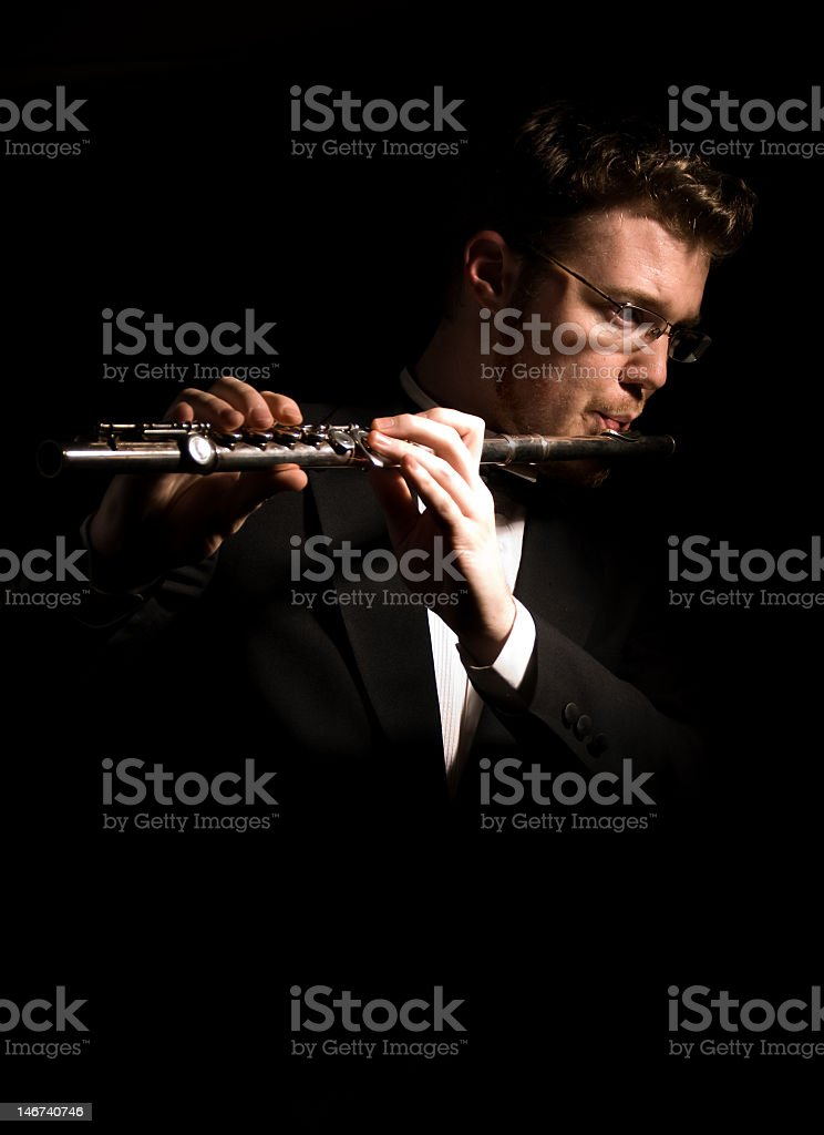 Orchestral Flute Player in Tuxedo royalty-free stock photo