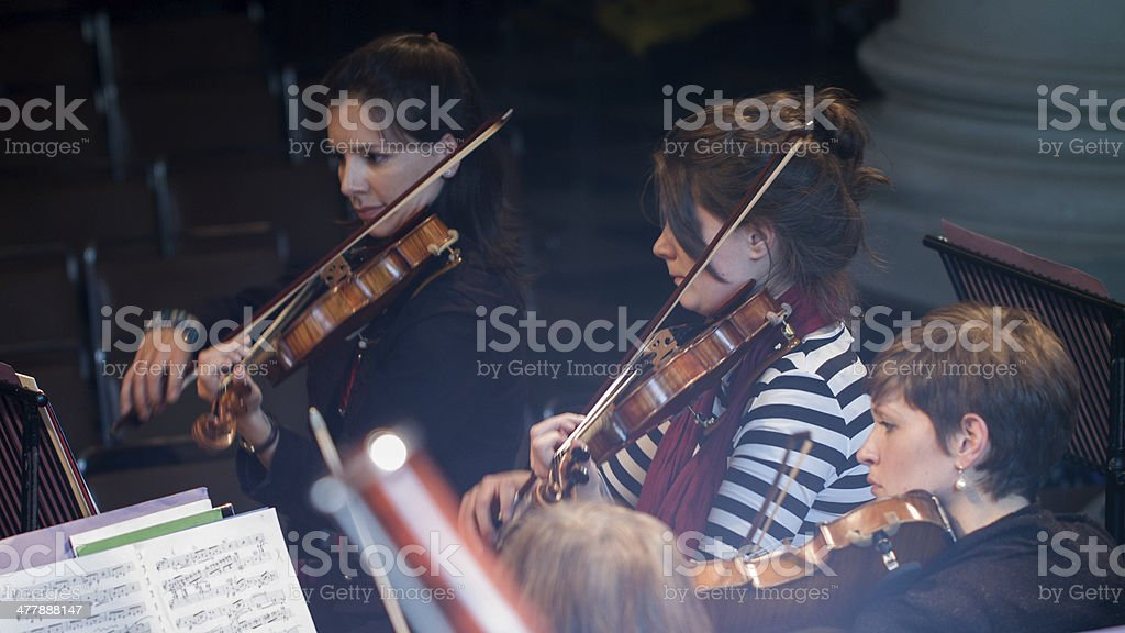 Orchestral string section in rehearsal stock photo