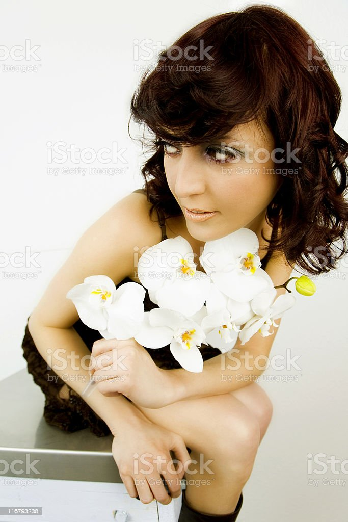 orchid and young woman royalty-free stock photo