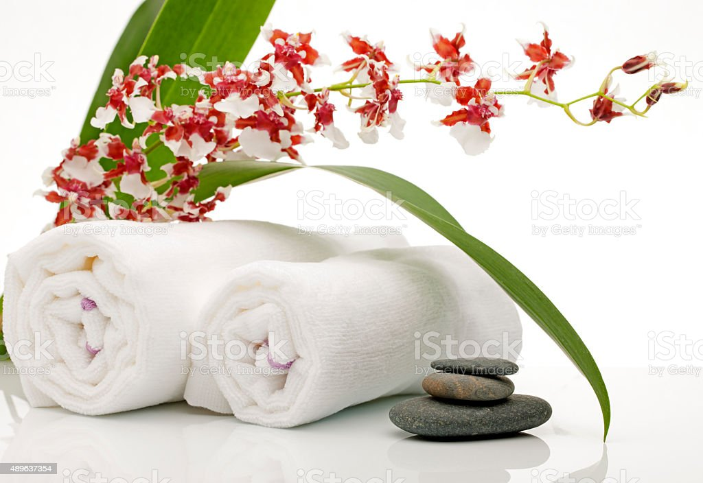 Orchids and Towels at Health Spa stock photo