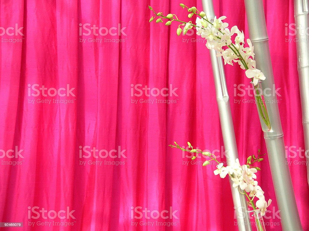 Orchids in front of pink thai silk royalty-free stock photo
