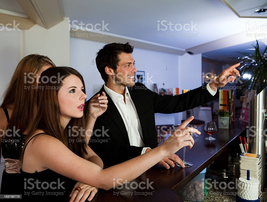 Ordering drinks at the bar royalty-free stock photo