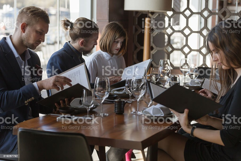 Ordering meal from menu stock photo