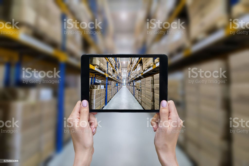 Ordering on-line from modern warehouse stock photo