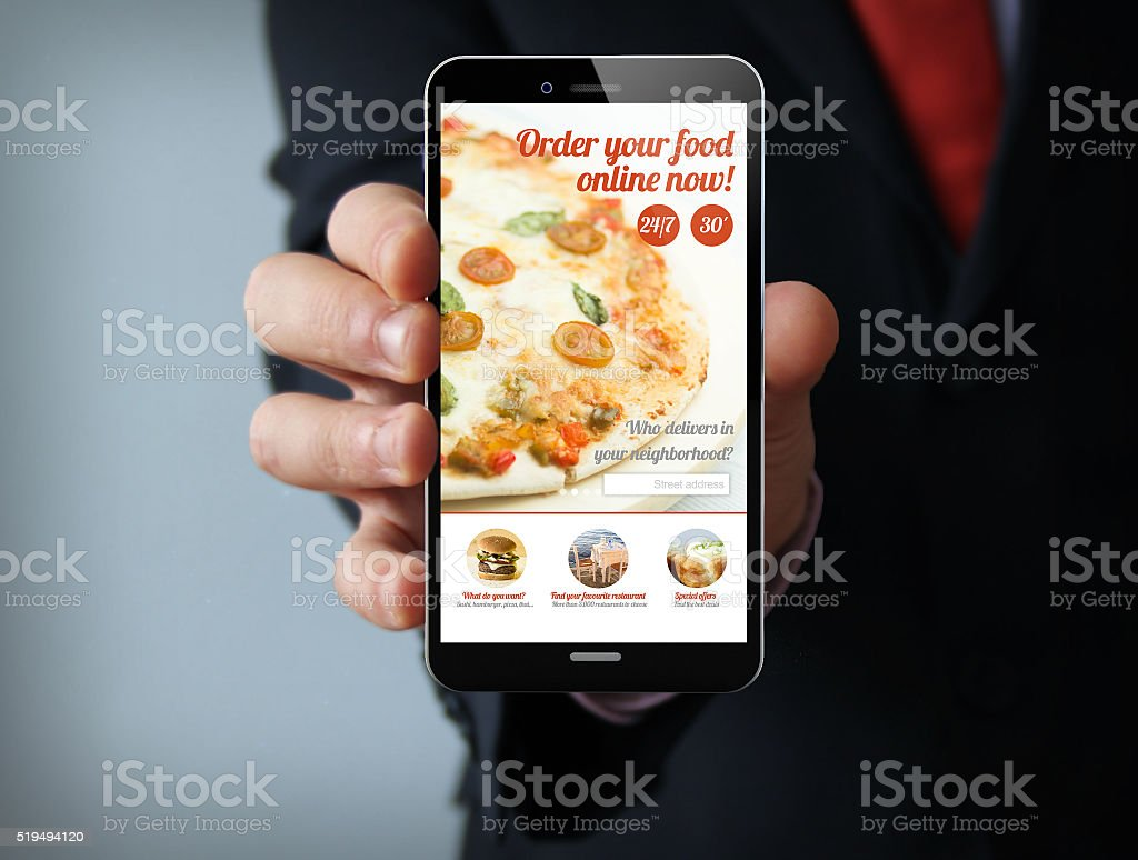 ordering pizza businessman smartphone stock photo
