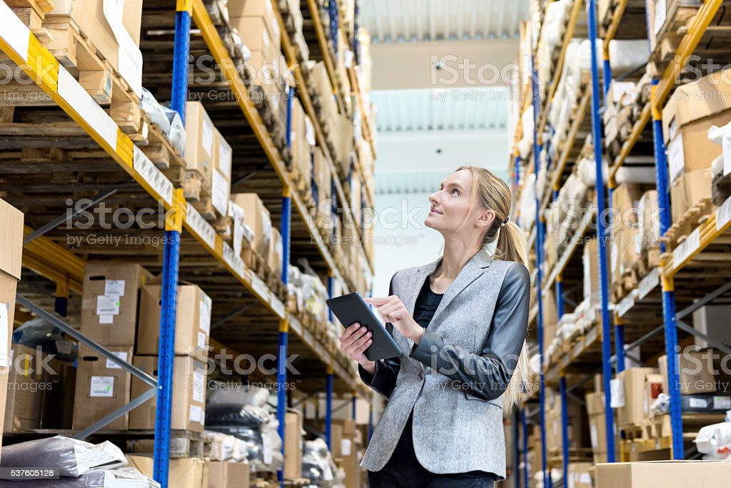 Ordering with digital tablet in warehouse stock photo