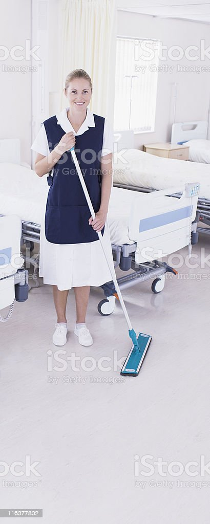 Orderly sweeping in hospital royalty-free stock photo