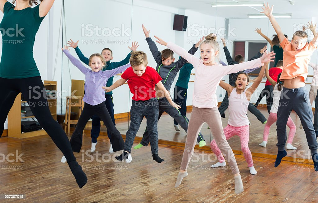 Ordinary boys and girls studying contemp dance stock photo