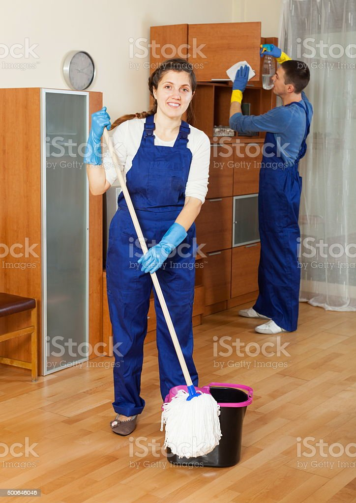 Ordinary cleaners cleaning living room stock photo