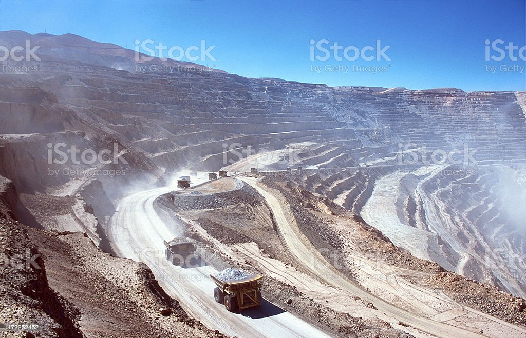 Ore trucks in an open-pit mine royalty-free stock photo