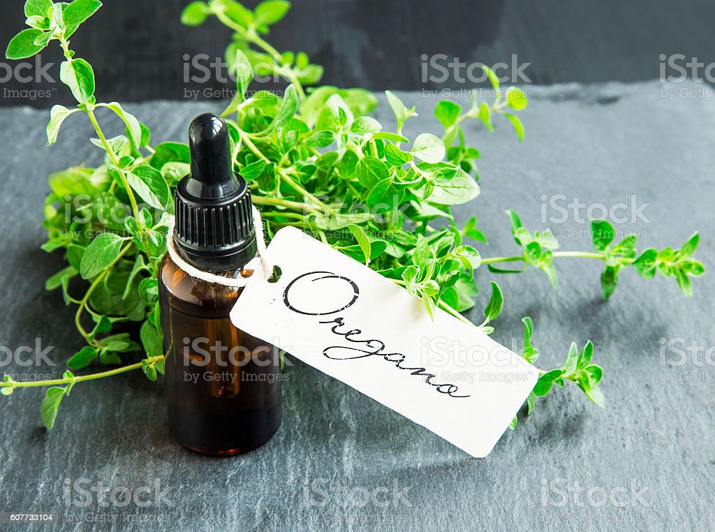 Oregano oil bottle with label stock photo