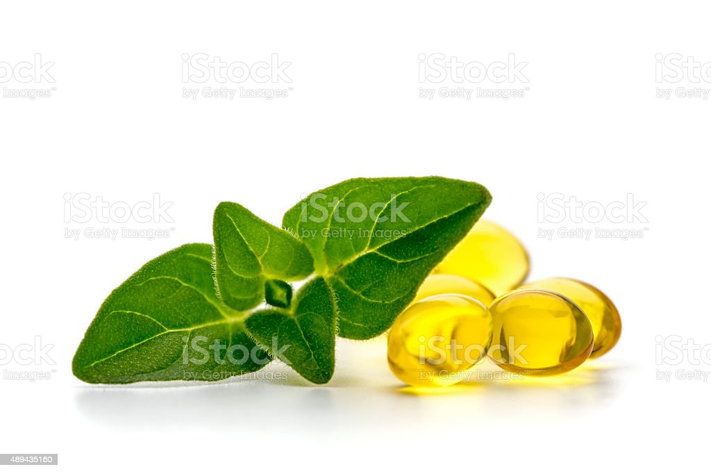 Oregano oil capsules stock photo