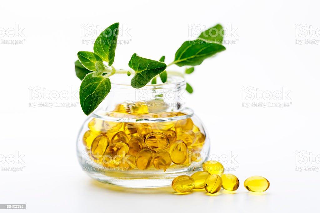 Oregano oil softgel capsules stock photo