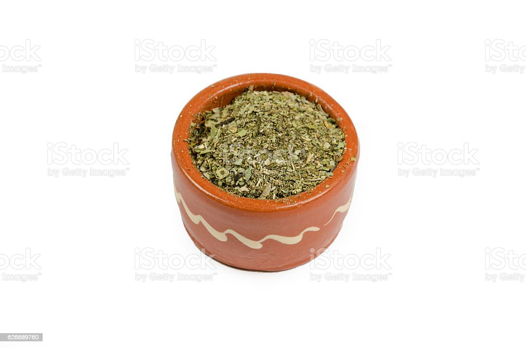 oregano spice in a cup or bowl stock photo