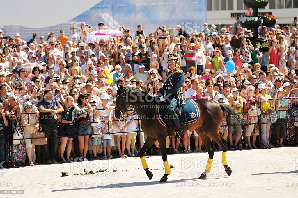 Orel city day. Crowd of people watching horse guard stock photo