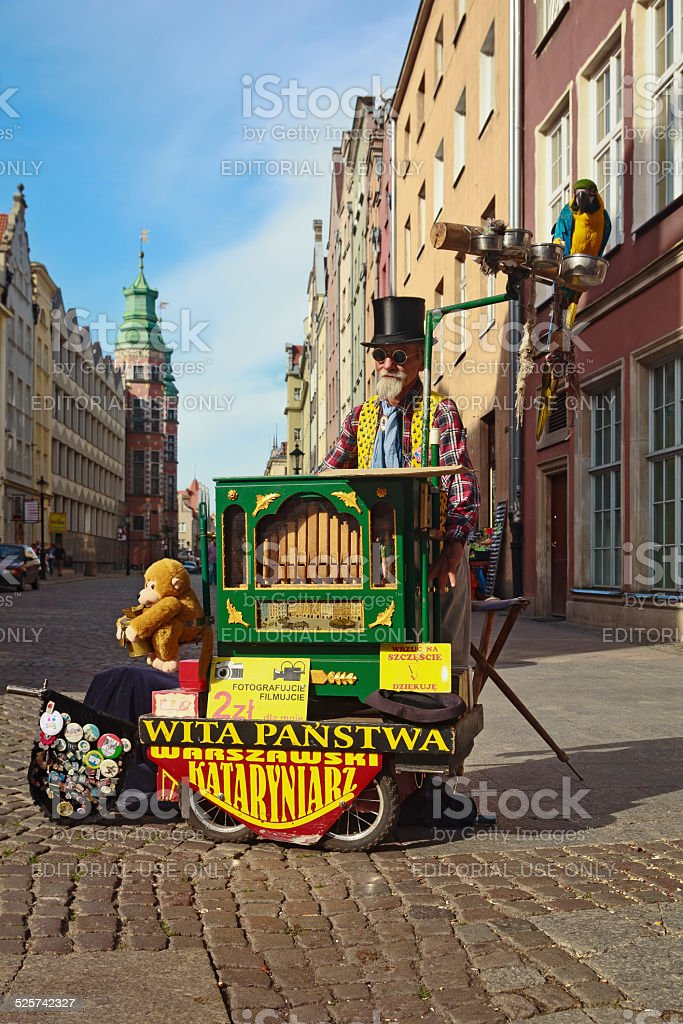 Organ grinder with a parrot, Gdansk, Poland stock photo
