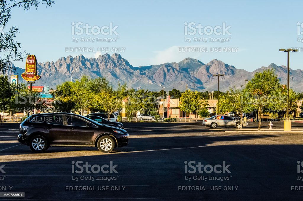 Organ Mountains in New Mexico in downtown city shopping center parking lot stock photo